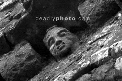 A carved head on the tower at the Hill of Slane