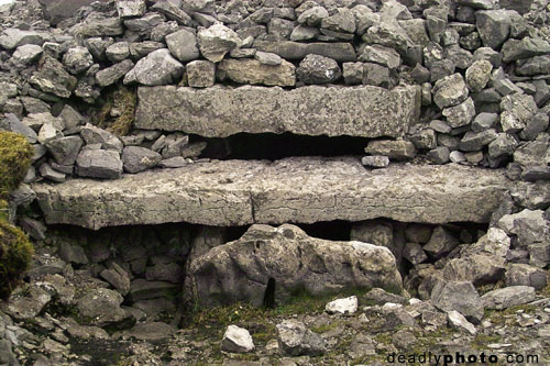 Exterior of Cairn G, with entrance stone, Carrowkeel
