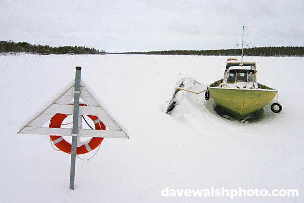 Boat on frozen lake, Nellim, Lapland, Finland