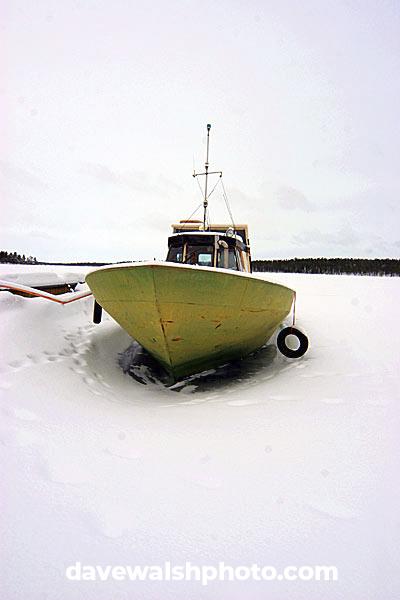 Boat on frozen lake, Lapland, Finland