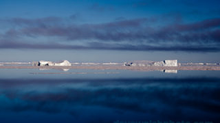 Arctic icebergs and low cloud in Kane Basin, North West Greenland