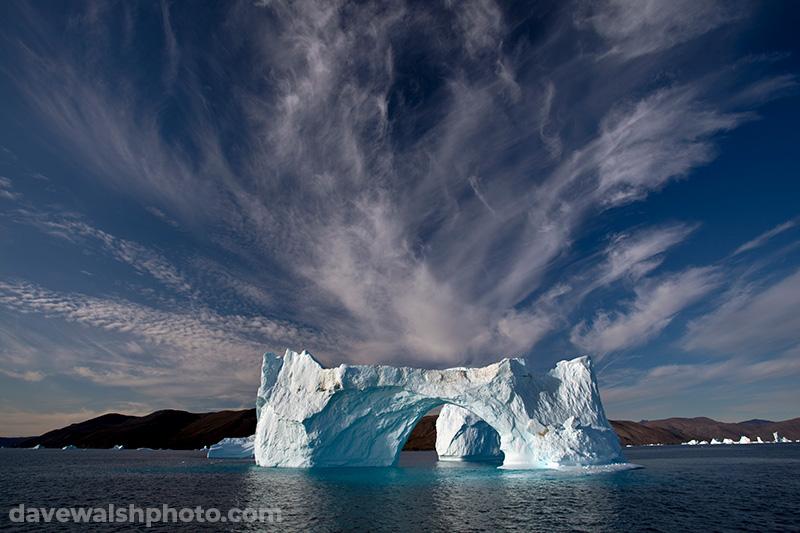 Iceberg: Cirrus clouds over iceberg