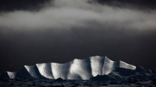 Iceberg under cloud, Kangerdlussuaq Fjord, East Greenland