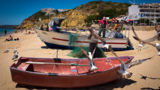 Fishermen cleaning nets in Salema