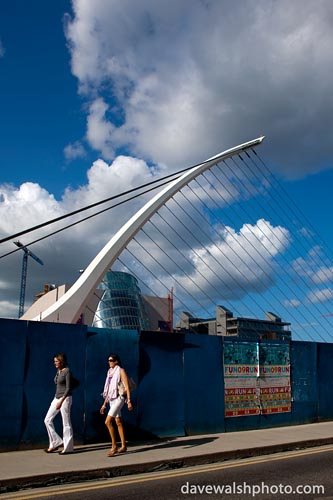Two women walking by the Samuel Beckett Bridge, Dublin by Santiago Calatrava