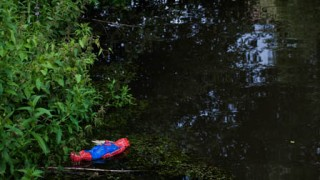 Dead spiderman, facedown in a canal, Amsterdam